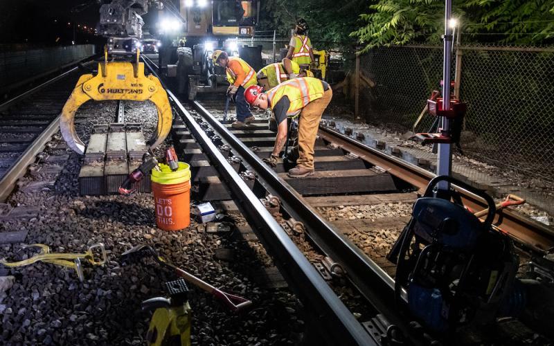 A crew works on the Orange Line in Medford