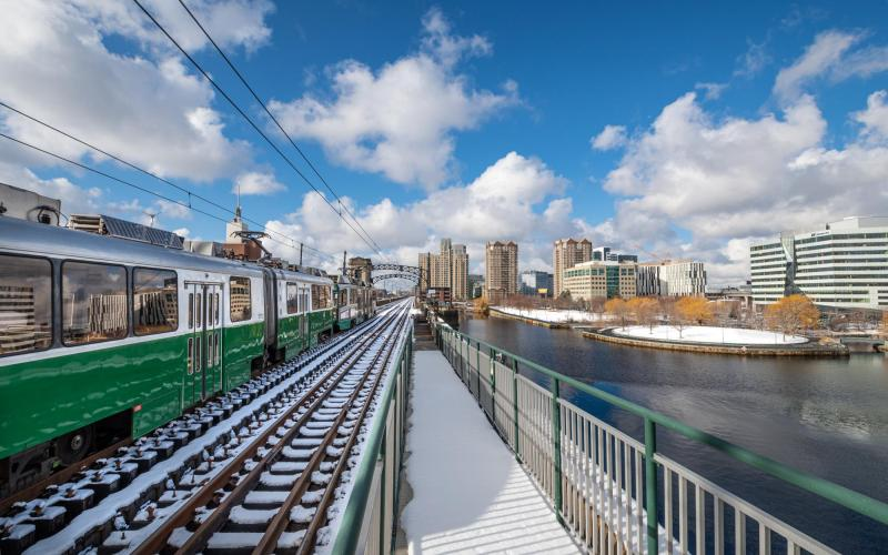 Green Line train crosses the Charles River between Science Park and Lechmere.