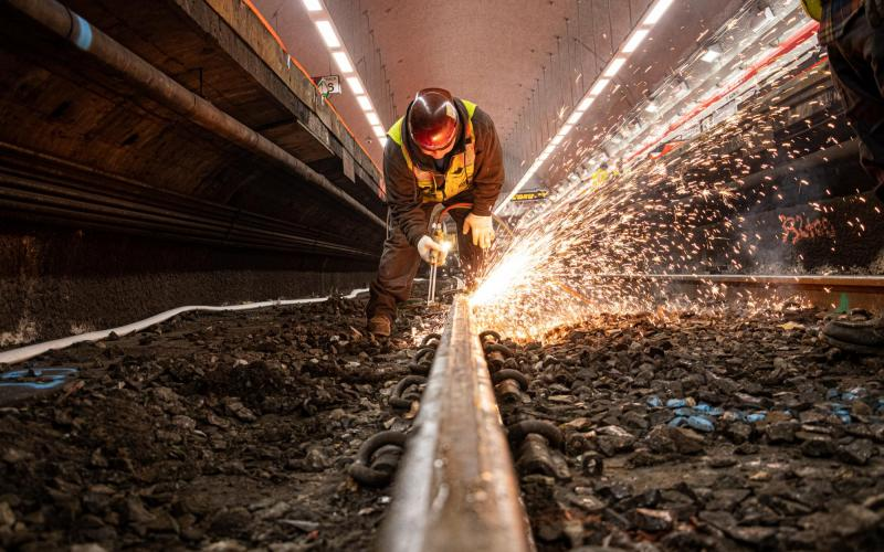 A crew member welds a section of track at Park Street as part of the December 6 – 8, 2019, Red Line weekend shutdown