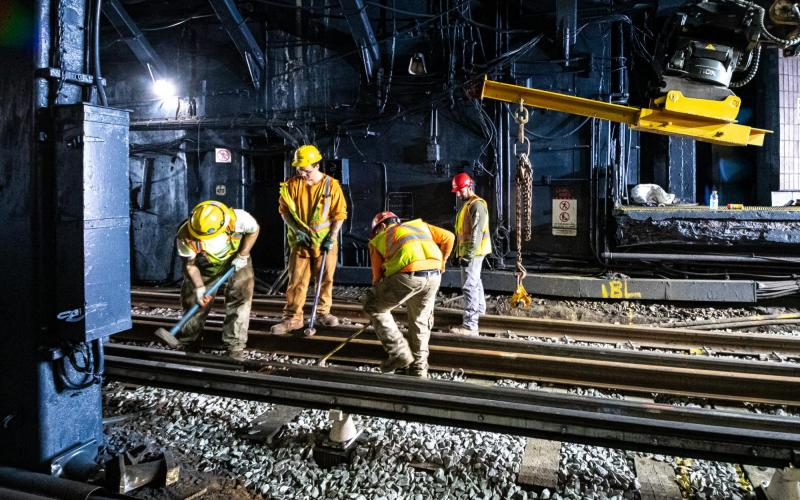 A crew installs continuous welded rail on Haymarket's northbound side during the January 24–26, 2020, weekend shutdown
