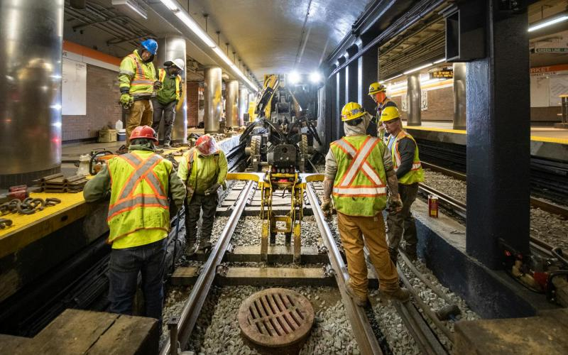 Crew members work on rail tie replacement during the final Orange Line weekend shutdown of winter 2020