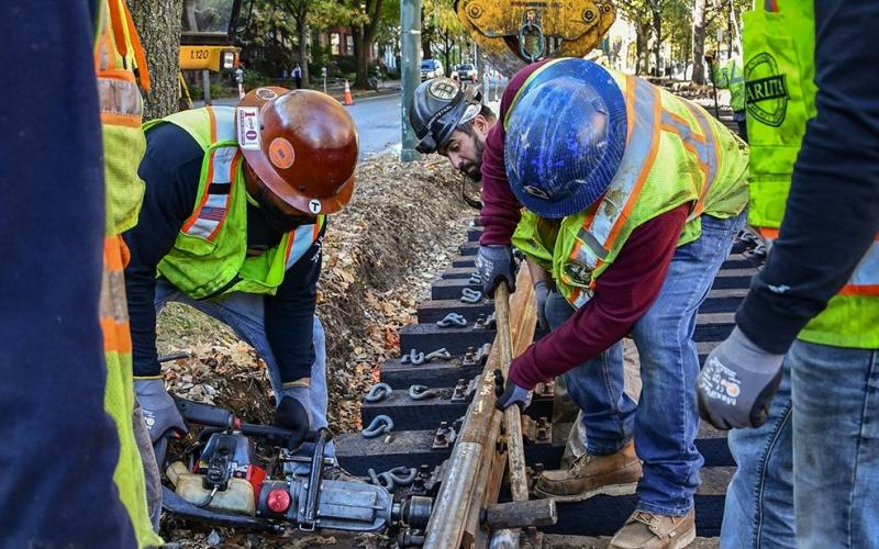 Workers make repairs to Green Line track in fall 2019