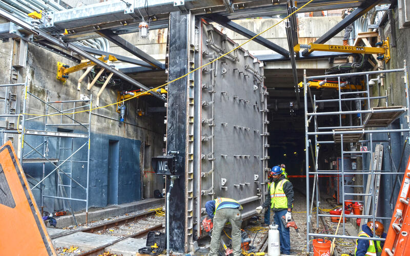 Crews install the steel doors at Fenway Portal. The project is now complete (November 23, 2020)