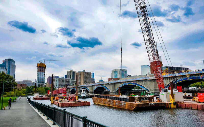 Cranes lift materials onto the Lechmere Viaduct as crews work on the rehabilitation project (October 2020)