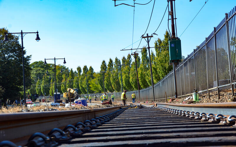 A crew works on B Branch track and intersection upgrades as part of the Green Line Transformation (October 2020)
