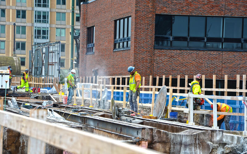 A crew works on tracks as part of the Lechmere Viaduct Rehabilitation (October 2020)