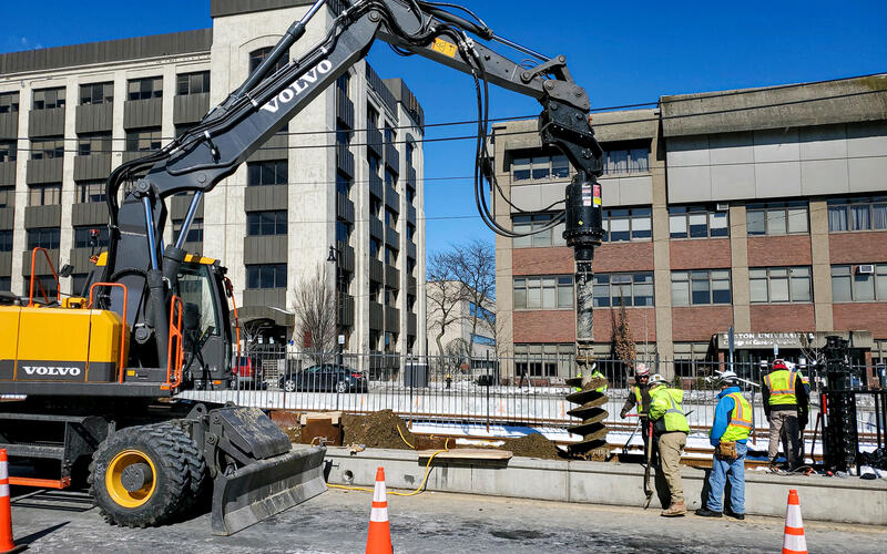 Crews drill shafts along Commonwealth Ave as part of B Branch Consolidation work