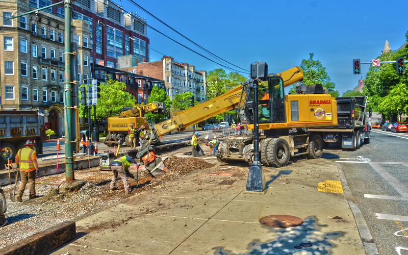 Crews excavate the intersection at Cummington Mall on the B Branch