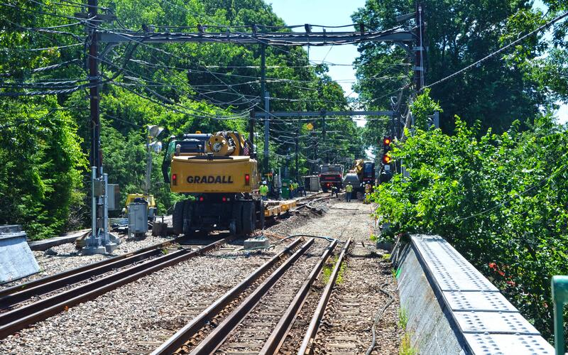 Crews use machinery to replace cables as part of D Branch Track and Signal Replacement