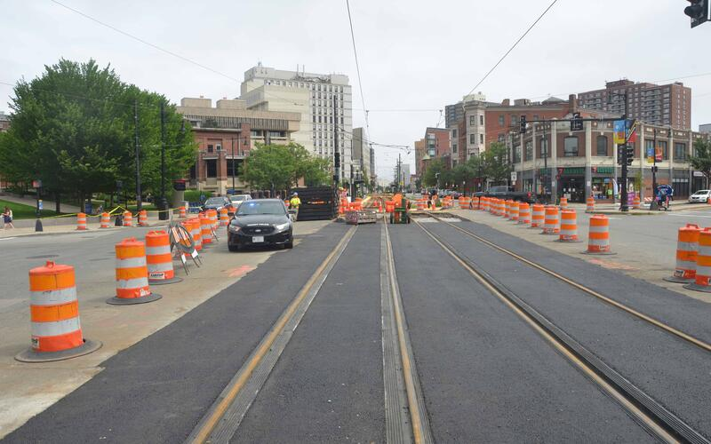 A photo of fresh tracks and pavement at the Tremont St/Francis St and Huntington Ave Intersection