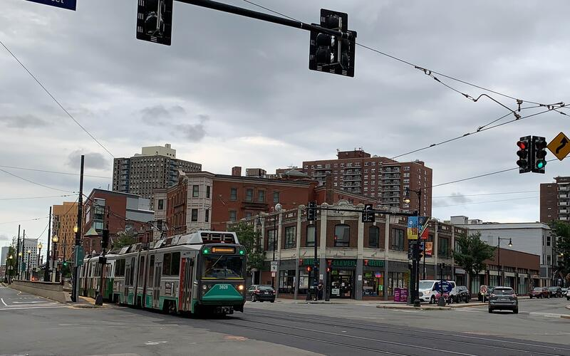 A green line trolley running regular service on the newly completed E Branch track