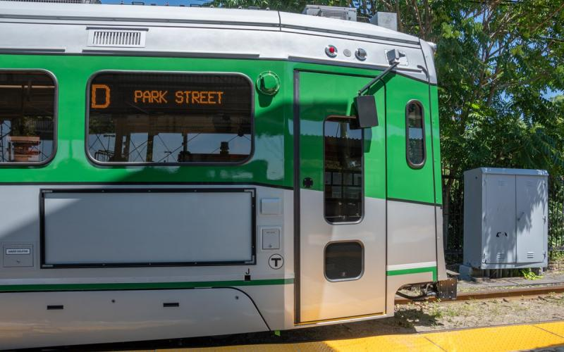 A new Green Line car at Riverside Station, profile view of the door