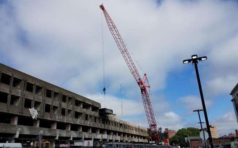 Quincy Center garage demolition, with a large red crane